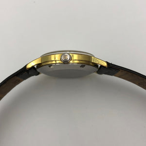 Gold plated winding crown with Omega logo