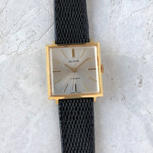 Square gold watch