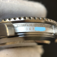 Rolex serial number behind bracelet