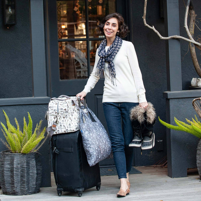 woman traveling with weekender bag and scarf