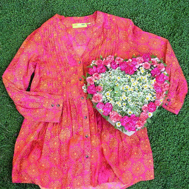 Pink tunic and heart-shaped flower box for Valentine's Day