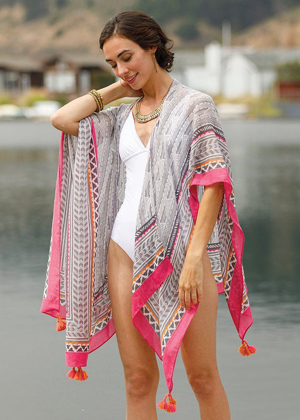 woman wearing grey and pink kimono wrap over a bathing suit