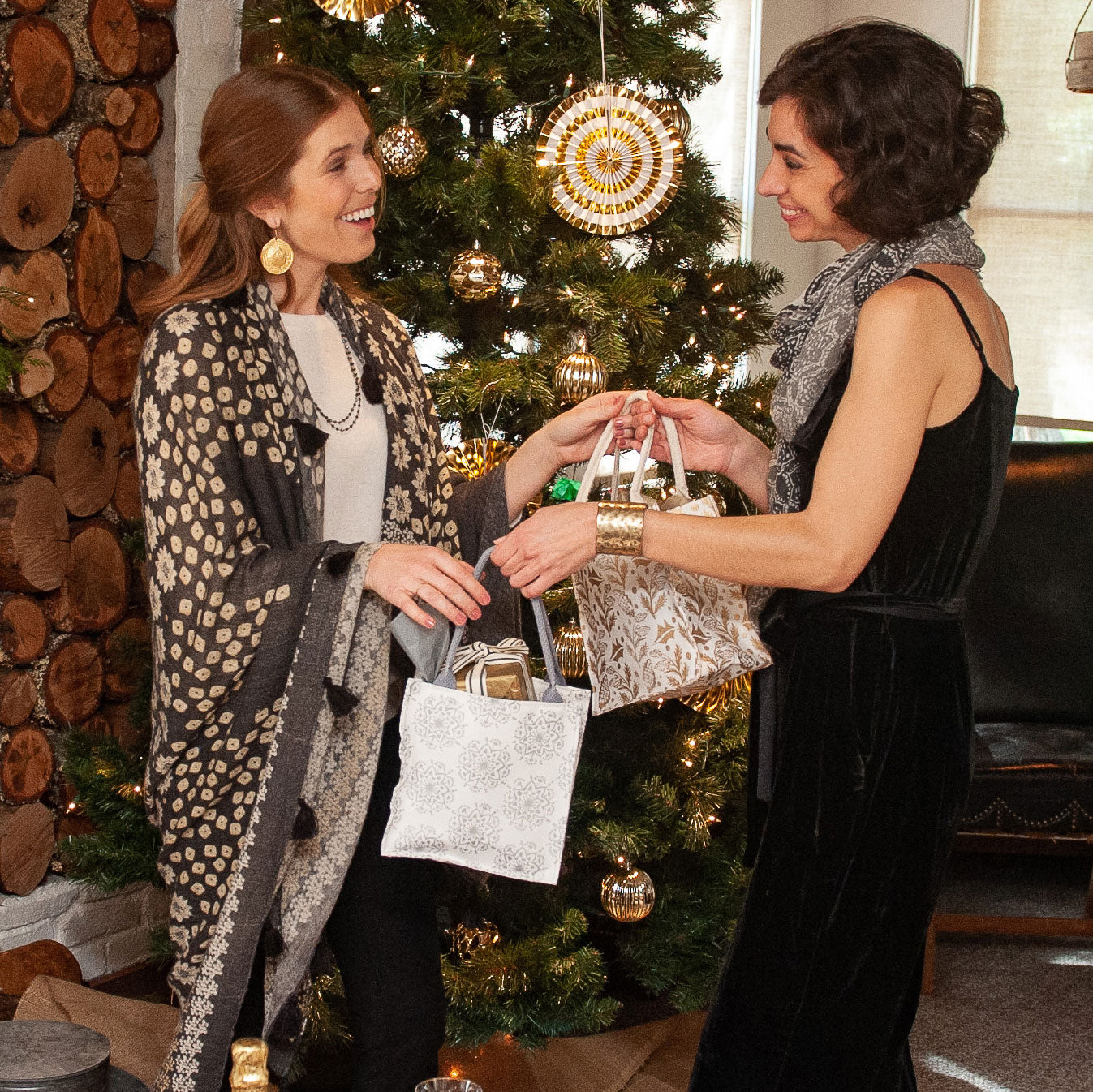 Holiday gift exchange with metallic gold and silver canvas gift bags