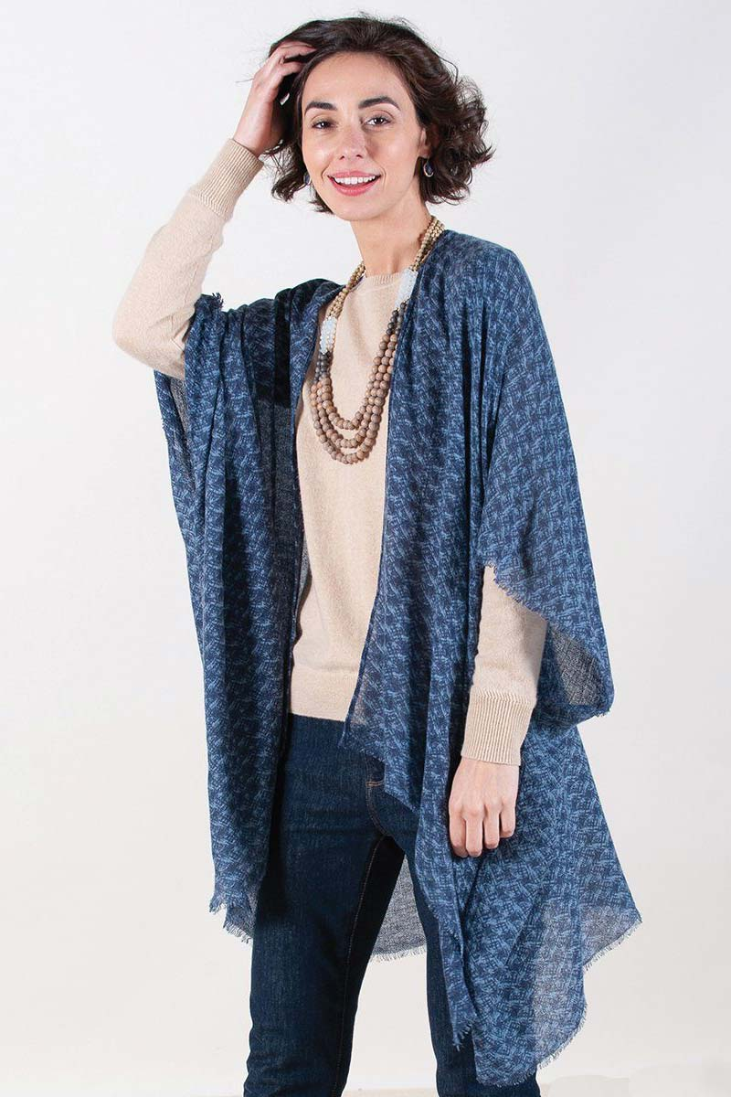 woman wearing blue printed fringe kimono with sweater and jeans