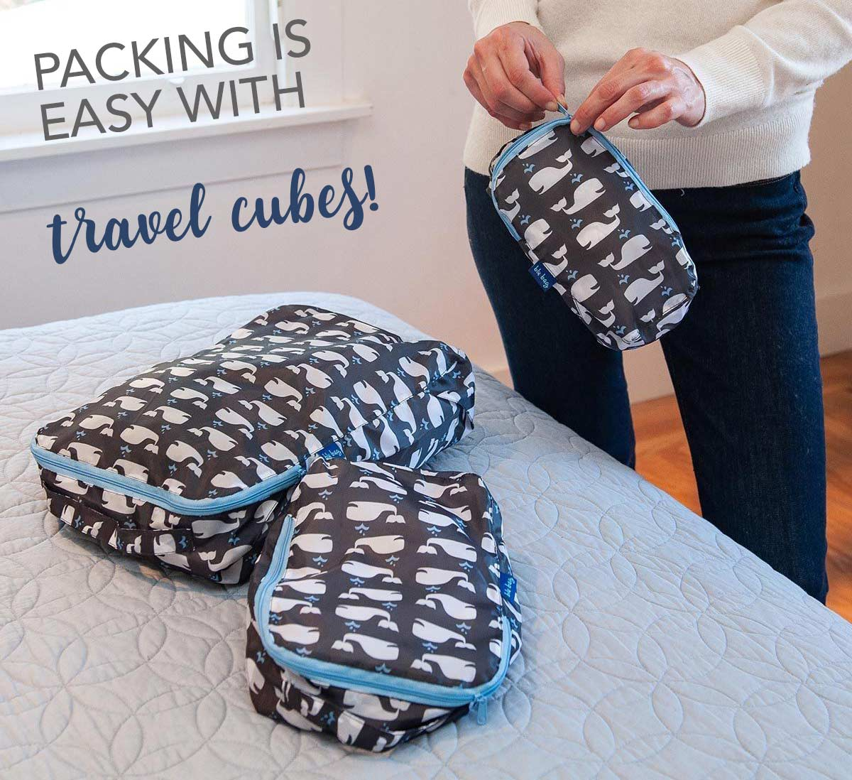 three travel cubes in a whale print make packing easy