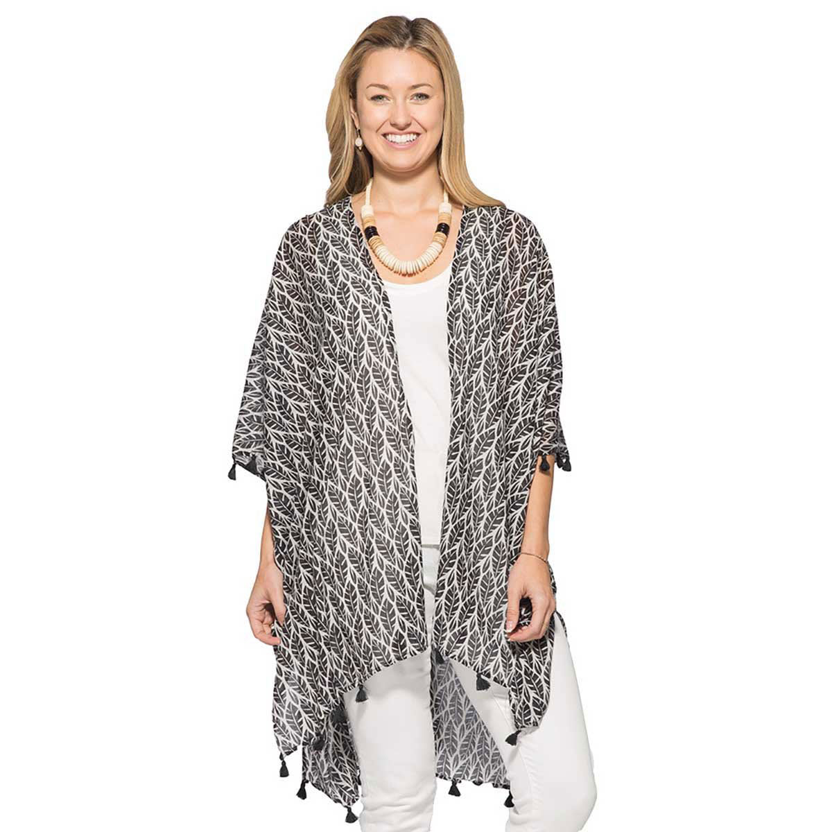 black and white kimono bathingsuit cover up with a pretty palm print and tassel trim