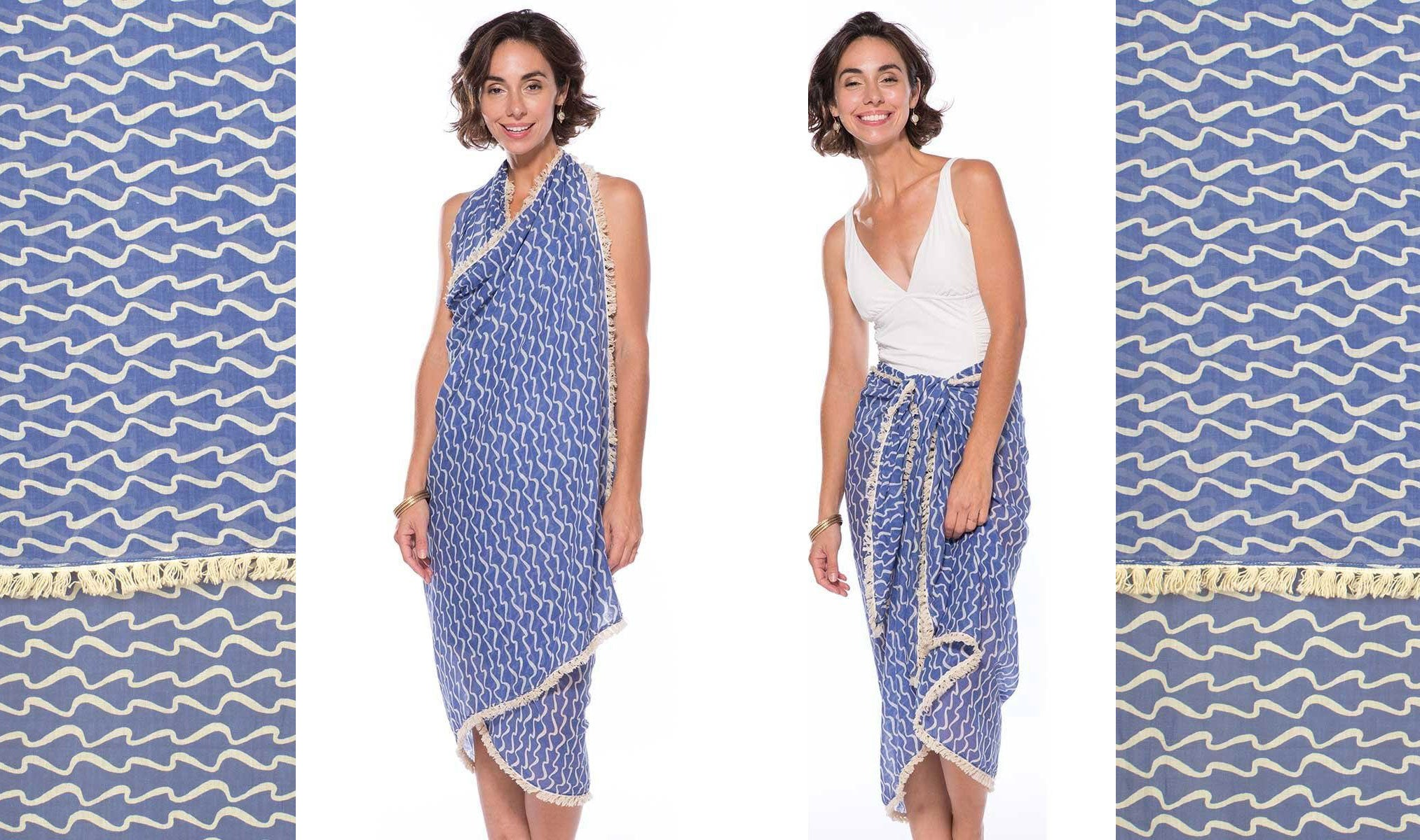 Blue and white pareo with wave print, worn 2 ways as beach skirt and a sarong