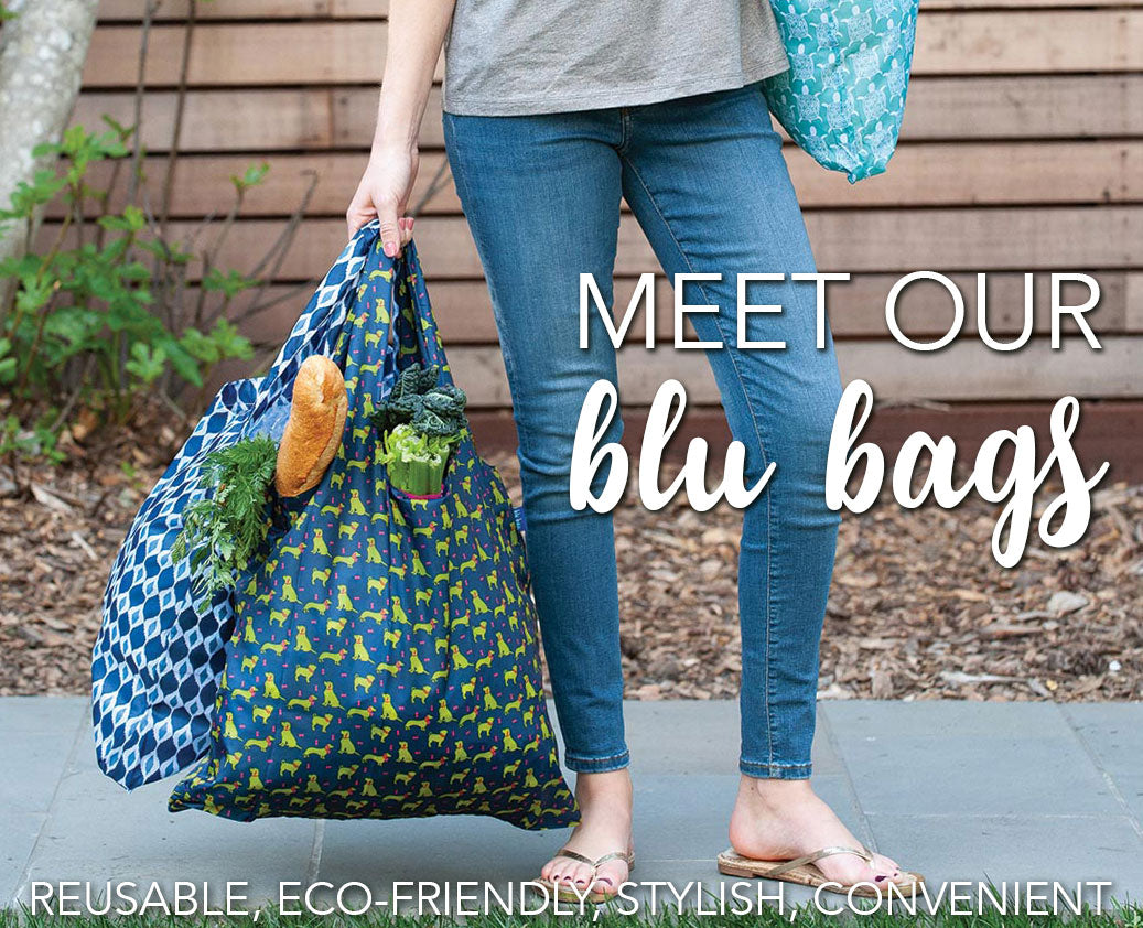 woman holding reusable blu bag shopping bags filled with groceries