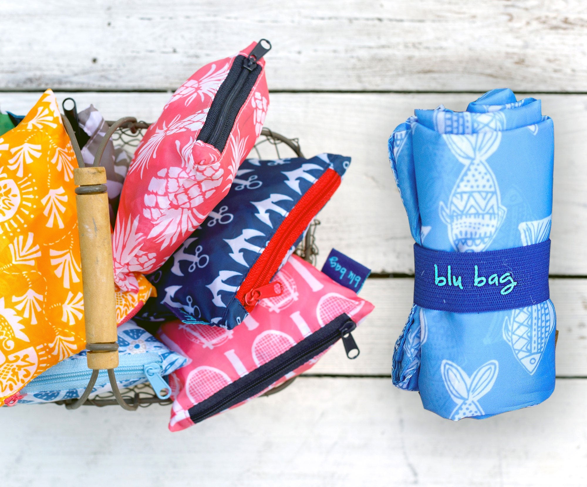 reusable blu bags in zipper pouches and rolled up with an elastic band