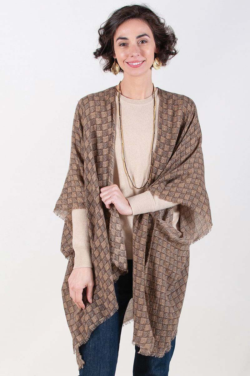 woman wearing brown printed fringe kimono with tan sweater and jeans