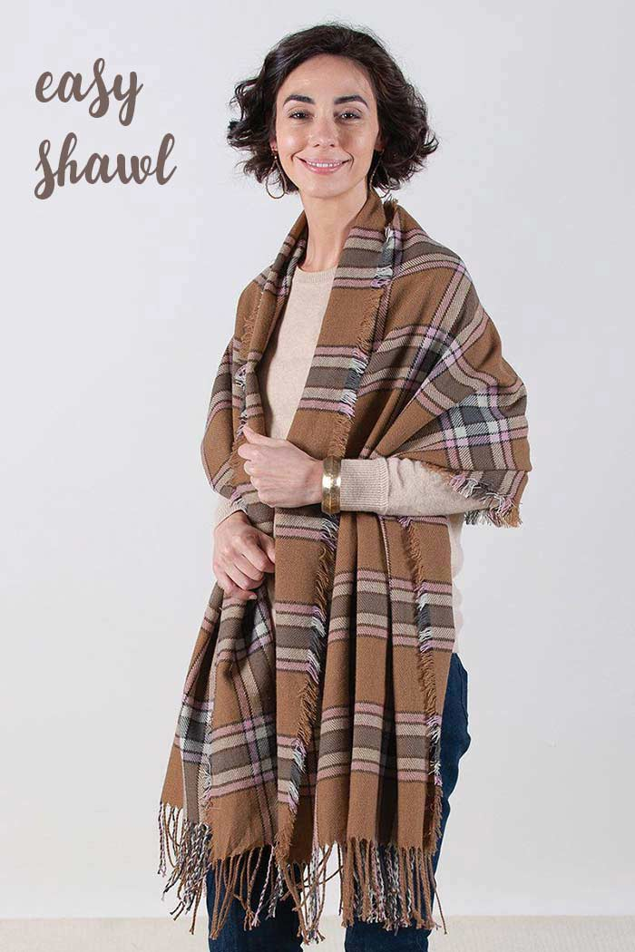Wear a plaid wrap as an easy shawl over your shoulders