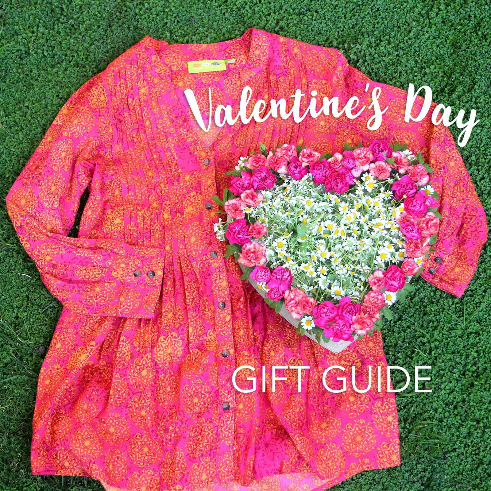 a pink women's tunic and a heart-shaped floewr box for valentine's day gifts