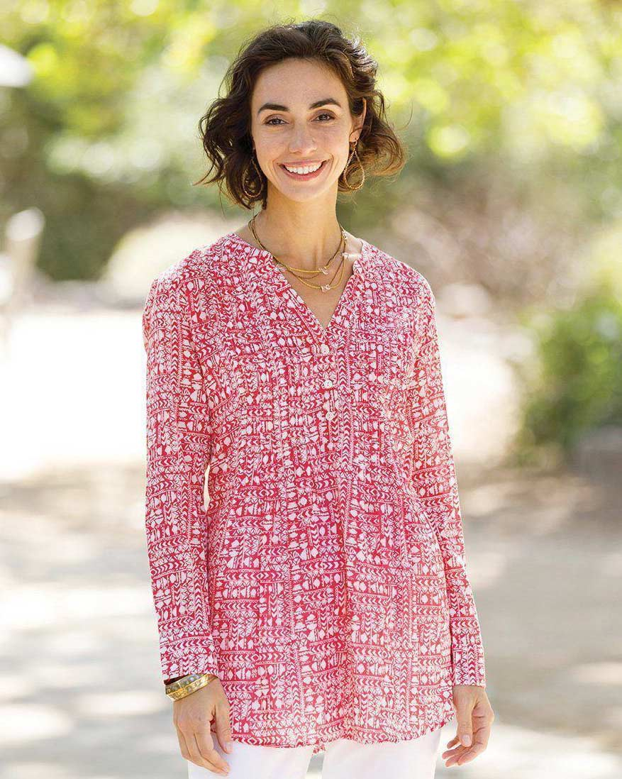 woman wearing pink printed pintuck tunic
