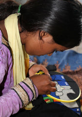a rural woman embroidering