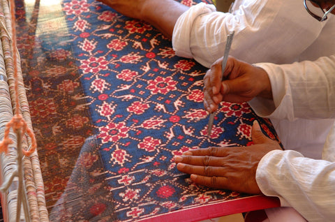 Double Ikat weaving on a loom