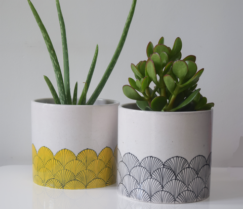 Yellow and black and white blue pottery planters
