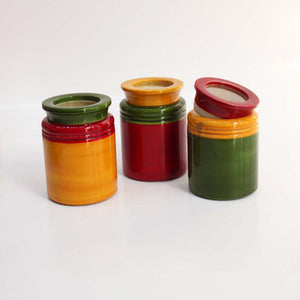 red, yellow and green jars with mixed colour lids