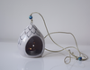 front view- black and white floral patterned tealight holder with blue beads on string
