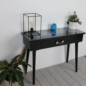 Kala Tile Top Console Table featured with plants and objects