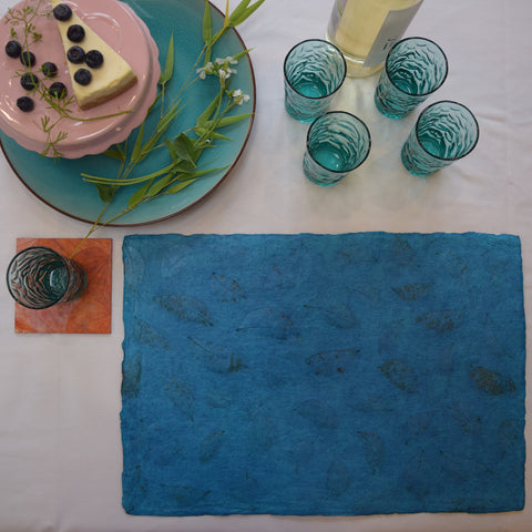 turquoise recycled paper tablemat with benjamin leaf imprint