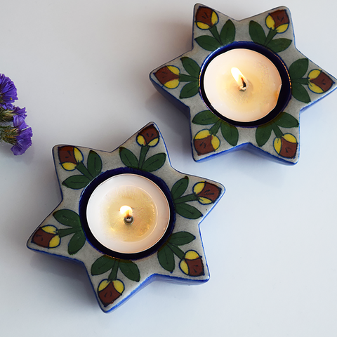 Blue star shaped diya with yellow and red hand painted flowers