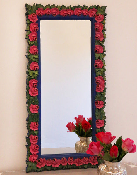 front image of indigo blue frame with all around pink roses and green leaves