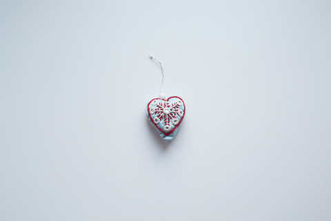 Single light blue Christmas heart with red and white embroidery and mirror work