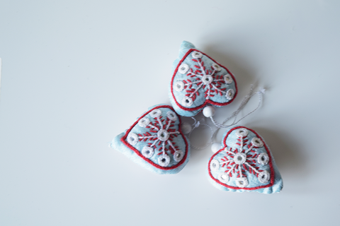 3 Light blue heart shaped Christmas decoration with white and red embroidery and mirror work