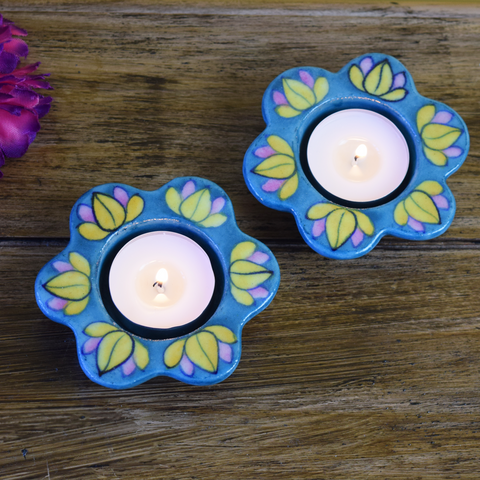 Blue diyas with yellow and pink lotuses