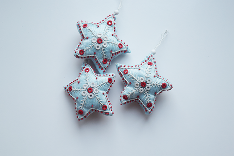 3 Light blue star shaped Christmas decorations with white and red embroidery and mirror work