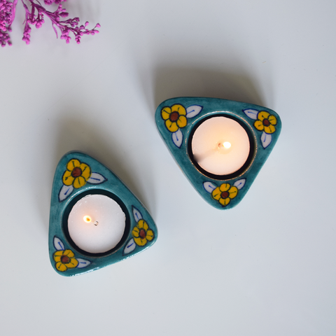 triangle-shaped blue tealight holders