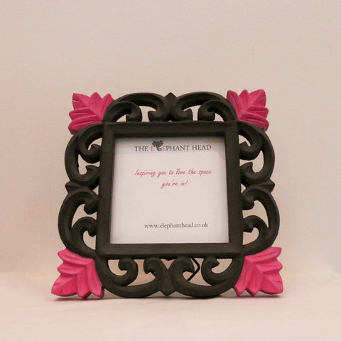 Charcoal surround and bright pink flowers front view of picture frame