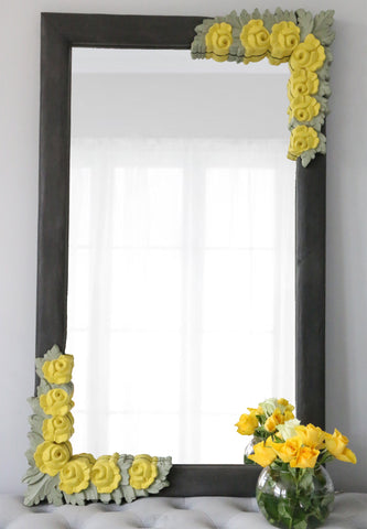 front image of charcoal frame with corner yellow flowers and olive green leaves