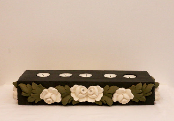 Charcoal base with all around white flowers and olive green leaves, front view