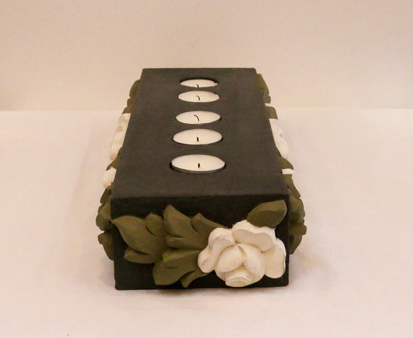 Charcoal base with all around white flowers and olive green leaves, side view