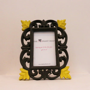 Charcoal surround and yellow flowers front view of picture frame