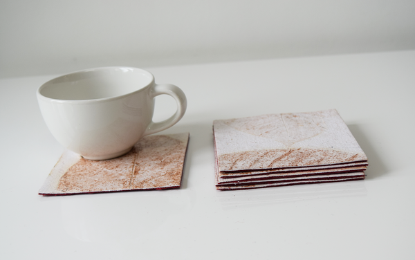 Cream Kadhambam coasters with cup