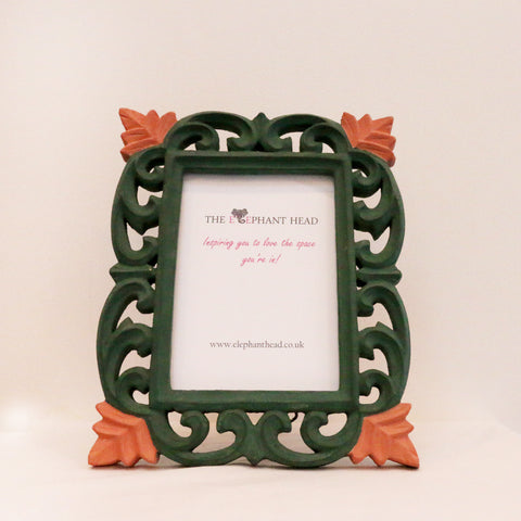Dark green surround peach flowers front view of picture frame