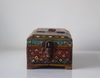 dark red barber box with floral motif- front view