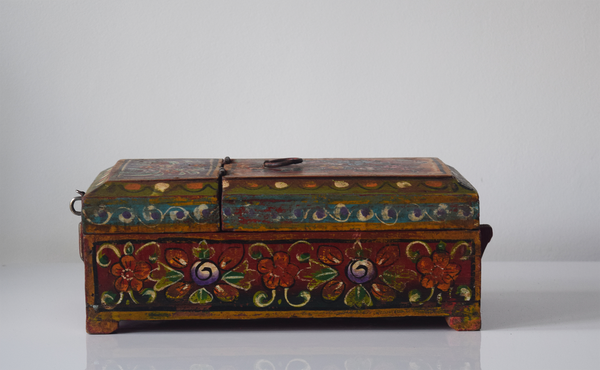 dark red barber box with floral motif- side view