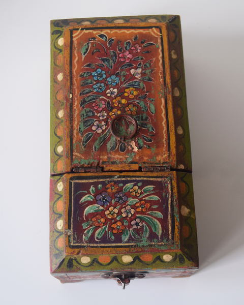 dark red barber box with floral motif- top view