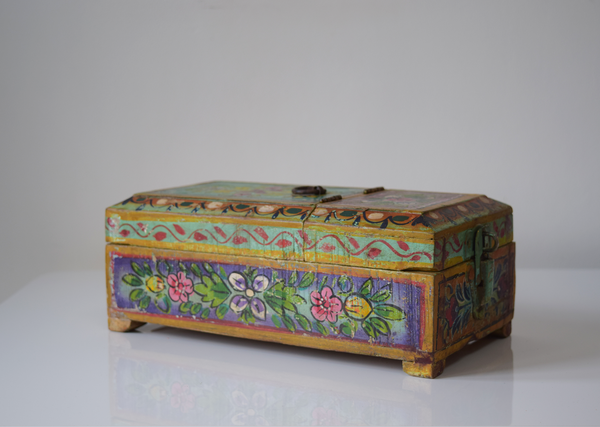 Mint green barber box with lilac, pink, yellow and white floral motifs-closed