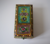 Mint green barber box with lilac, pink, yellow and white floral motifs-top view