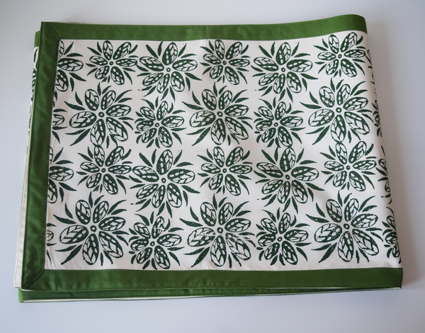 Cream with green floral pattern runner with a green border