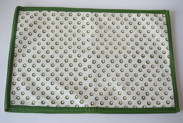 Cream with green circular pattern tablemat with a green border