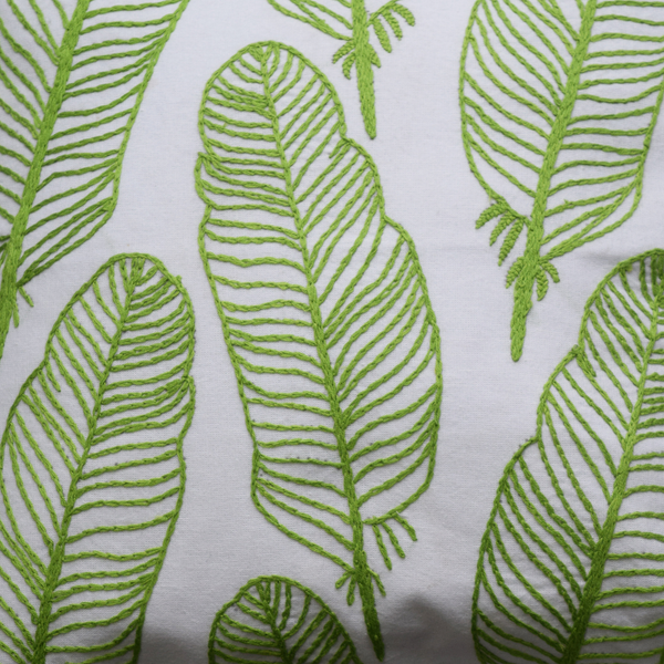Green feathers embroidery details on cushion cover
