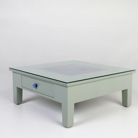 Sleti- Grey glass top coffee table, blue pottery tiles