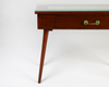 Brown console table with green tiled inlay front view with leg details