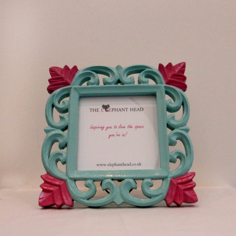 Teal surround and bright pink flowers front view of picture frame