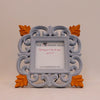 Pale blue surround and orange flowers front view of picture frame